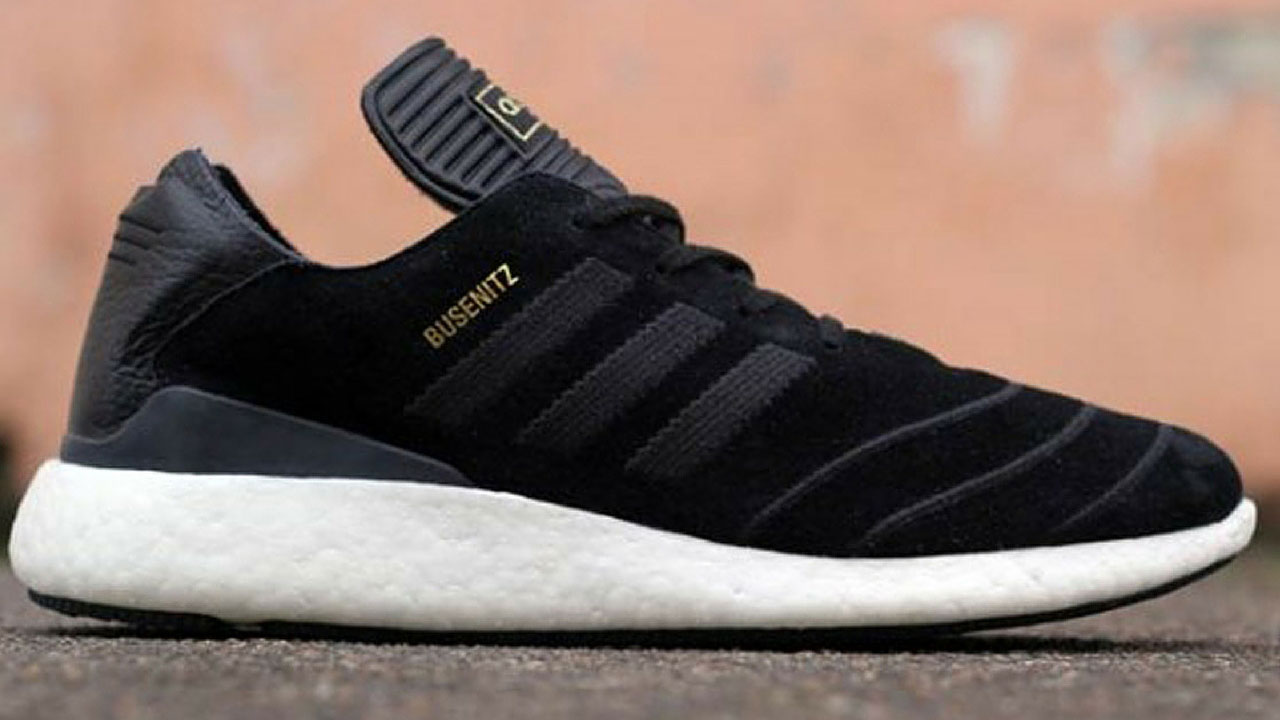 a4d6a1232 The Adidas Busenitz Pure features a black suede and leather upper part with  a white highrise sole combined with gold lettering on the side and on top.